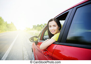 Beautiful woman in a car. - Woman in a car against the...