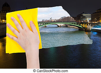 hand deletes night view of Paris by yellow cloth - travel...