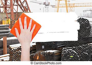 hand deletes industrial landscape by orange rag - ecology...