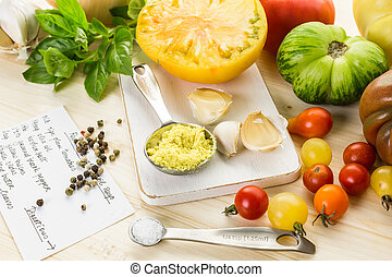 Ingredients to make roasted tomato soup with organic...