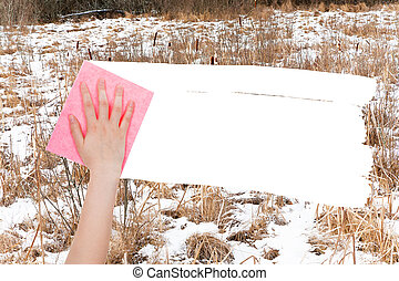 hand deletes frozen swamp by pink rag - season concept -...