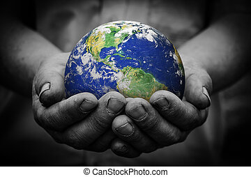 Earth in hand - Man holding an earth globe in his hands....