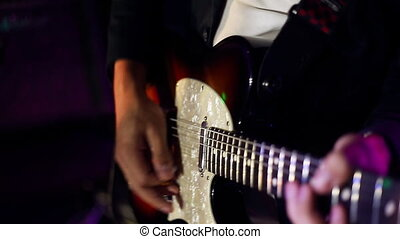 male musician with electric guitar playing
