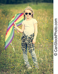 little cute girl posing with a kite