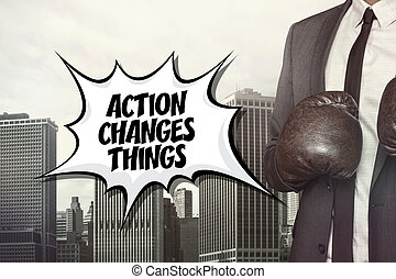 Action changes things text with businessman wearing boxing...