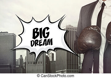 Big dream text with businessman wearing boxing gloves on...