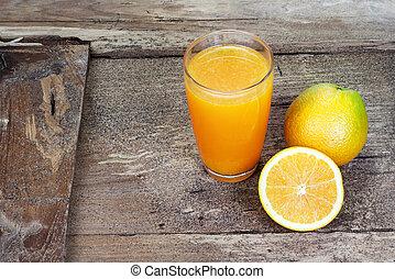 Orange fruit sliced in half - Orange sliced in half and...