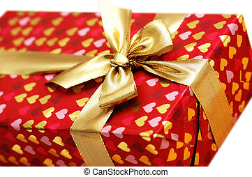 Close up of gift box with golden ribbon