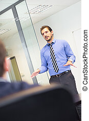 Business presentation on corporate meeting - Business man...