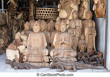 Wooden souvenirs for tourists in a market on the island of Bali. Ubud, Indonesia