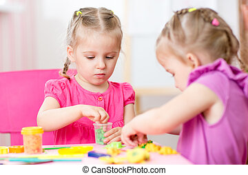 children girls play with colorful clay - kids girls playing...