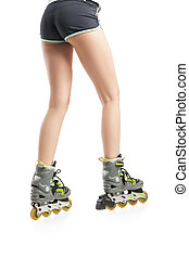 Close up picture of womans legs with rollerskates isolated...
