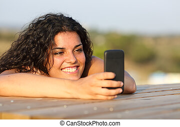 Funny girl watching media in smart phone - Funny girl...