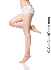 Beautiful wet feet, women legs on a white background -...