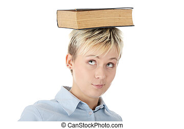 Teen student woman with book on head