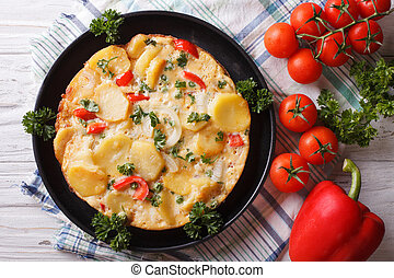 Hot Spanish Omelette on a pan close-up horizontal top view -...