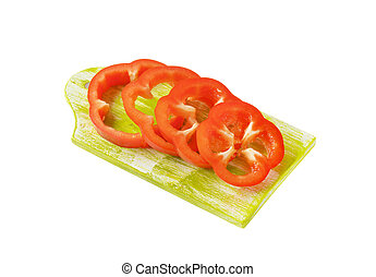 Sliced red bell pepper on cutting board