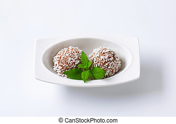 Chocolate coconut truffles - Chocolate truffles rolled in...