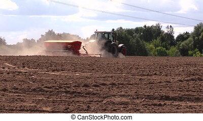 fertilize work field dust - Dust rise from tractor...