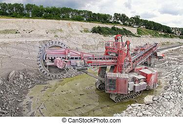 Bucket-wheel excavator in a chalk open pit mine. panorama...