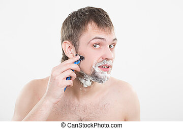 handsome young man with a shaving foam