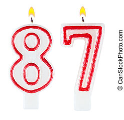 Birthday candles number eighty seven isolated on white...