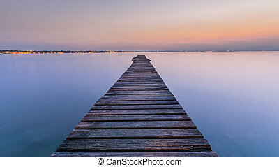Long Wooden Wharf on Garda lake at sunset - Long wood wharf...