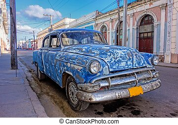 Classic American car in Cuba - Battered, patched up and old...