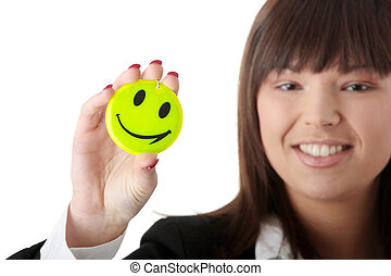 Smile - Business woman with smiley badge, isolated on white