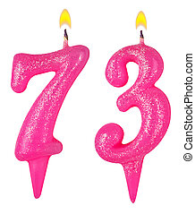 Birthday candles number seventy three isolated on white...