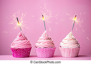 Pink cupcakes with sparklers - Three cupcakes with pink...