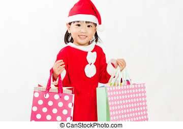 Asian Little Santa Claus with shopping bag in white isolated...