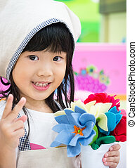 Florist occupation role playing girl - Adorable asian girl...