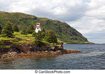 Newfoundland Lighthouse on a cloudy day.