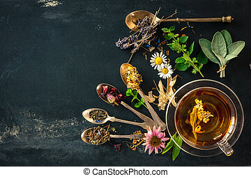 Herbal tea - Cup of herbal tea with wild flowers and various...