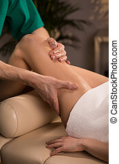 Relaxing massage with essential oils - Woman having relaxing...