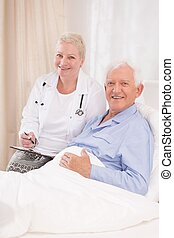 Caring doctor and her patient - Photo of mature caring...