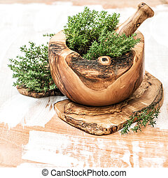 Mortar with fresh thyme herb Healthy food ingredients -...