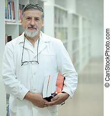 Renowned scientistdoctor in a library of research...