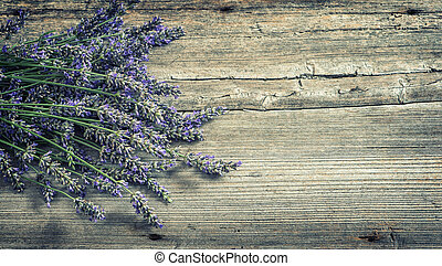 Lavender flowers on wooden background. Country style still...
