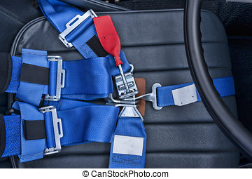 Safety harness. - A safety harness for a seat belt.