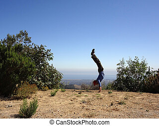 Man Handstands in the high mountains of Santa Barbara