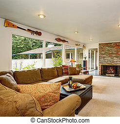 Bright living room with carpet and fireplace.