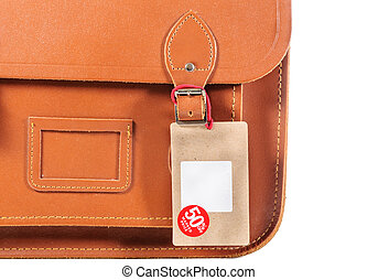 Leather bag with lable isolated on white background