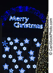 abstract merry christmas lights effects and christmas tree...