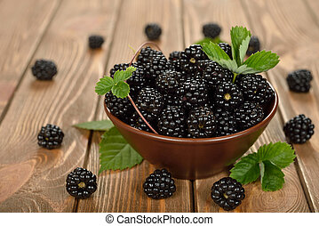 Fresh blackberries on a brown background