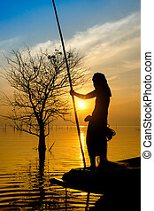 Silhouettes fisherman and sunset, Thailand