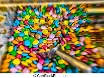 Colourful round shaped candies in a box.