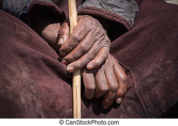 Old Tibetan man hand Ladakh, India - Old Tibetan man hand in...