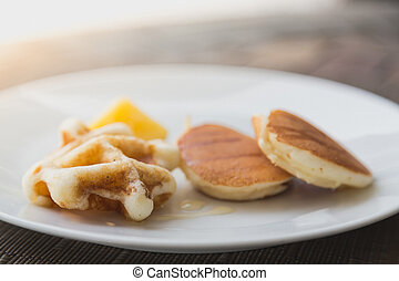 Pancakes with honey dipper